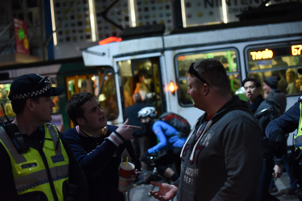 A member of the crowd [left] confronts the suspected UPF member [right]. Photo - Finbar O'Mallon