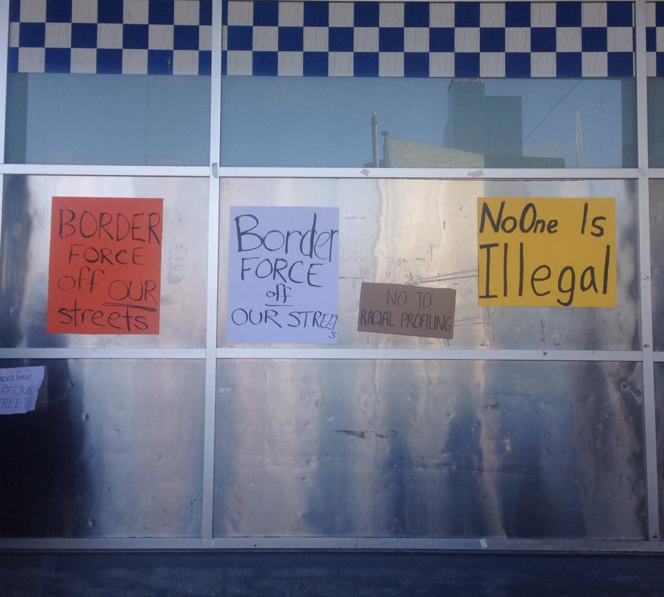 Protest signs on Flinders St Police Station. Photo- Katie Coulthard